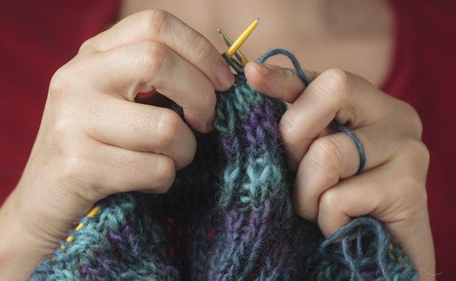 Woman knitting a sweater