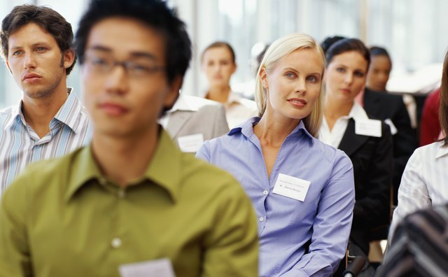 group of business executives sitting at a seminar