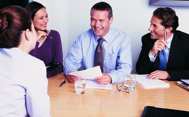 Three Business Executives Conducting an Interview Around a Table