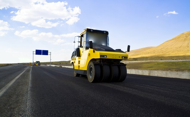 road roller leveling new fresh asphalt pavement