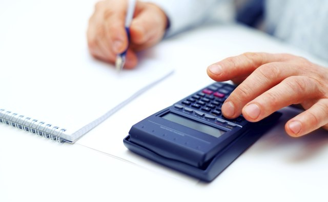 Closeup of a businessman calculating