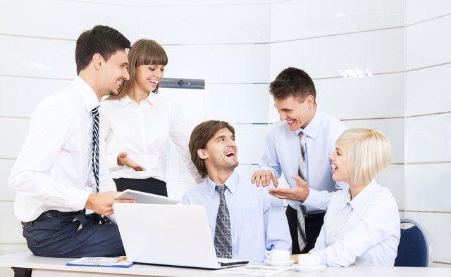 business people congratulating colleague office desk