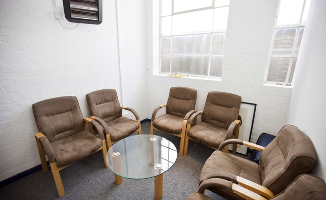 Interior of waiting room with chairs and table in television station