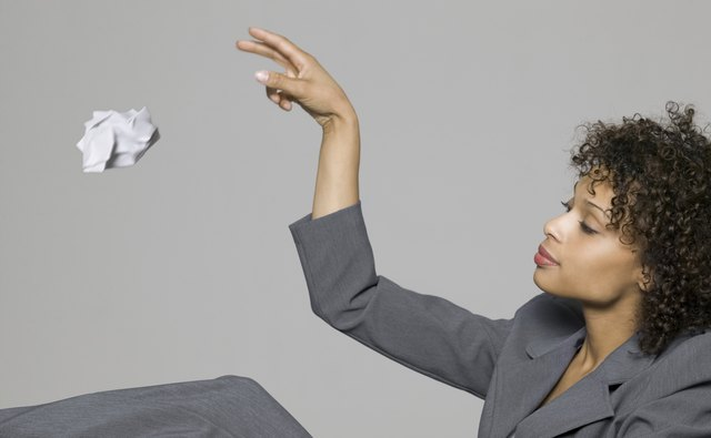 How long should a business keep credit card receipts bizfluent business portrait of a young adult woman in a grey suit as she throws away some reheart Gallery