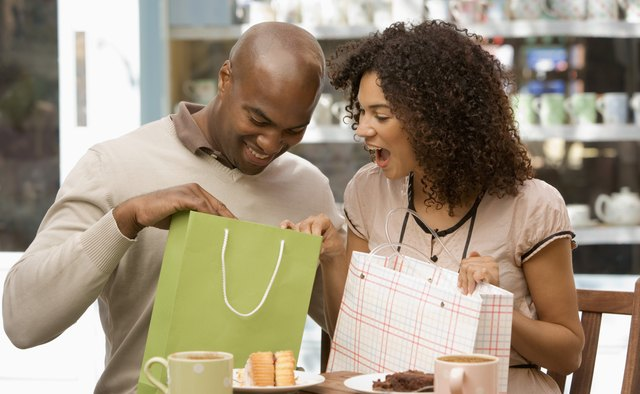 Couple looking in shopping bags