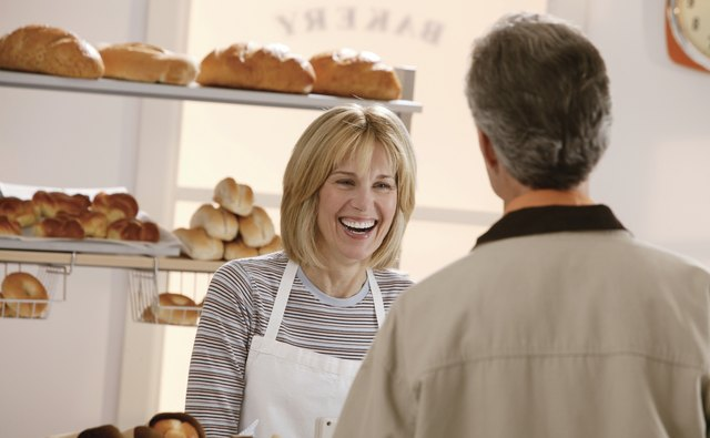 Woman talking to man in bakery