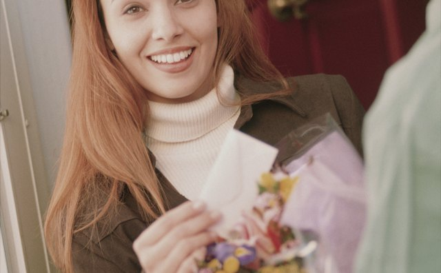 Woman receiving flower delivery