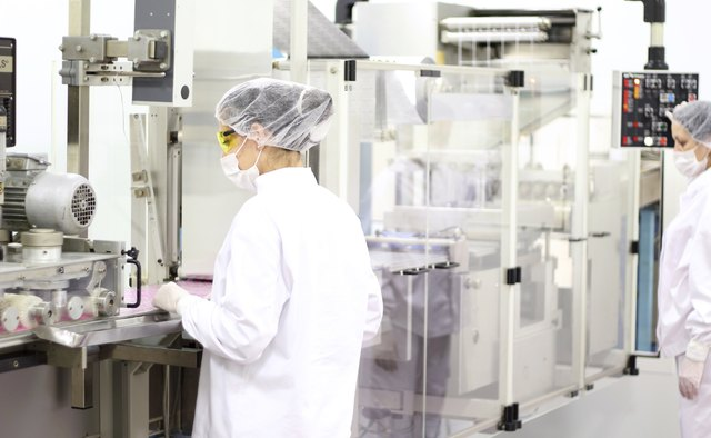 Female Workers At Pharmaceutical Factory