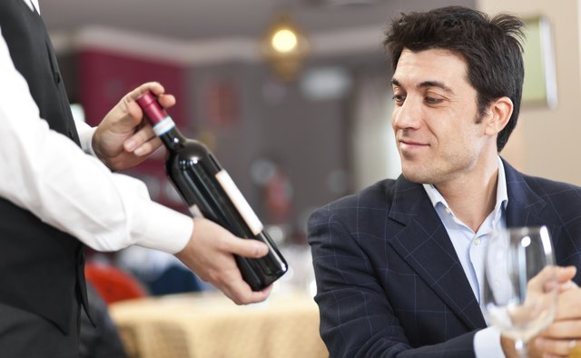 Waiter suggesting a bottle of wine