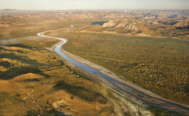 Aerial view of river through badlands, North Dakota