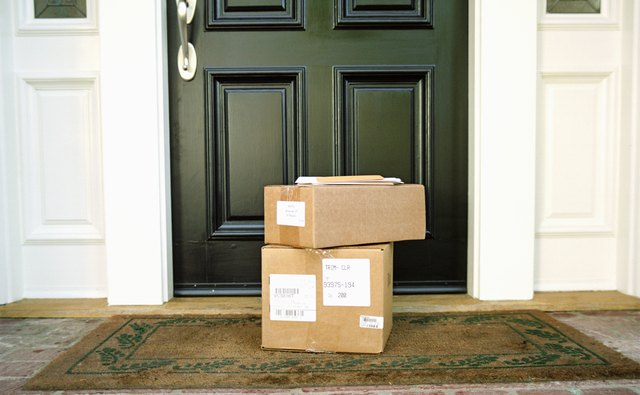 Boxes on doorstep of house