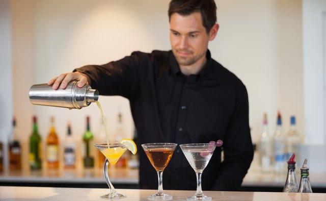Bartender pouring cocktails