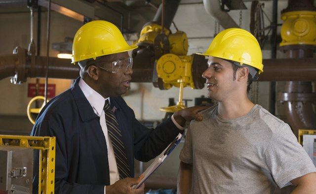 Manager and worker in waste treatment plant