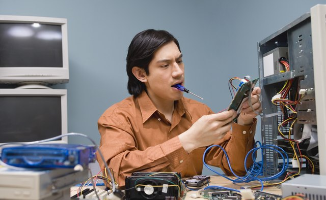 Tech support worker repairing computer