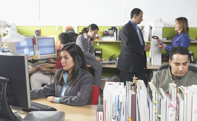 Five business executives in an office