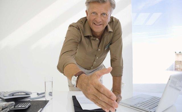 Businessman greeting with handshake