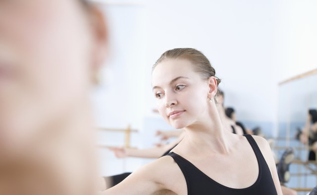 Young woman stretches into ballet pose