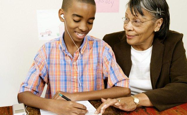 Grandmother helping boy with homework