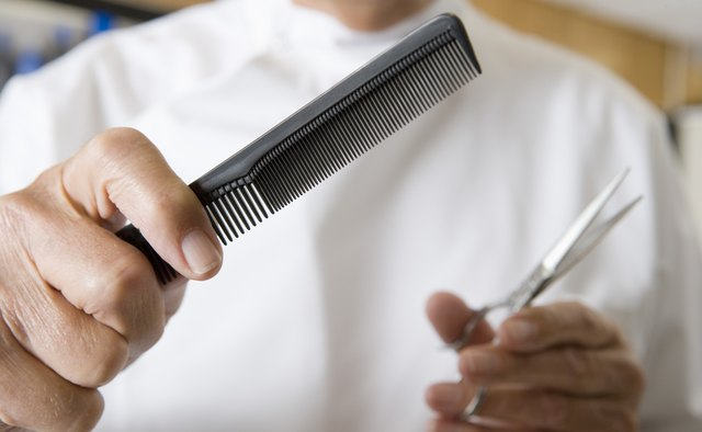 Barber with scissors and comb