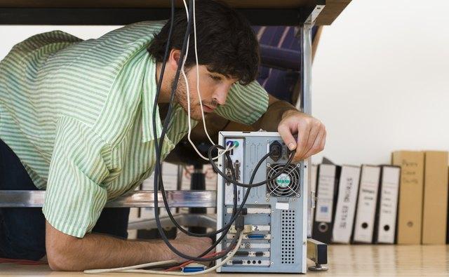 Man working on computer under desk