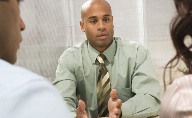 Businessman at meeting with coworkers