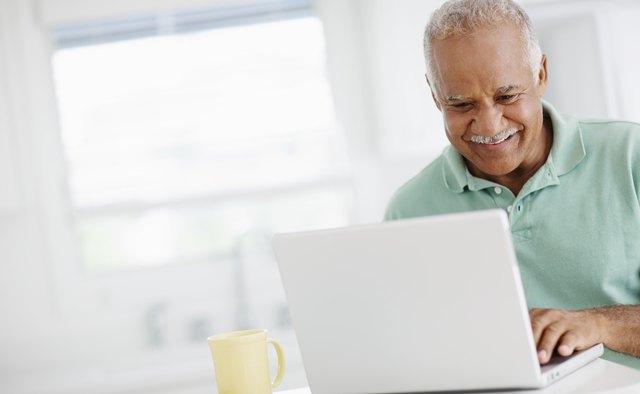 40 year old man looking at bank accounts online