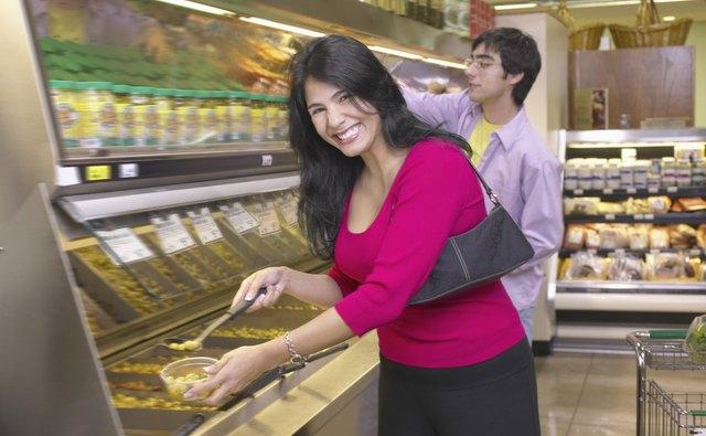Woman serving herself at salad bar