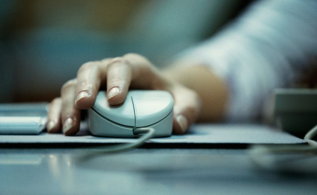 Close-up of a persons hand holding a computer mouse
