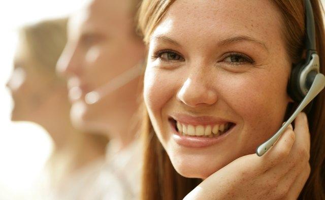 Smiling woman wearing telephone headset