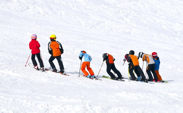 Children practicing ski