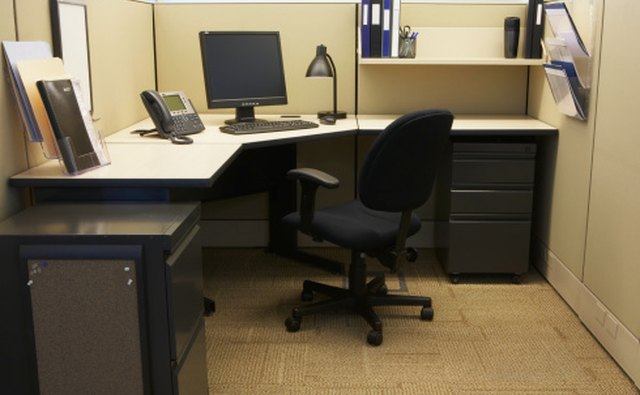 The workstation should provide ample room for the multiple tasks and include a swivel chair.