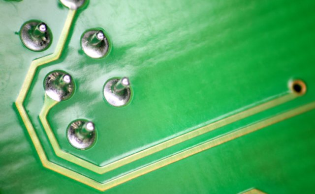 Wave soldering machines can process batches of circuit boards.