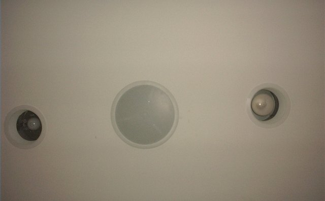 Personal client--in-ceiling surround speaker