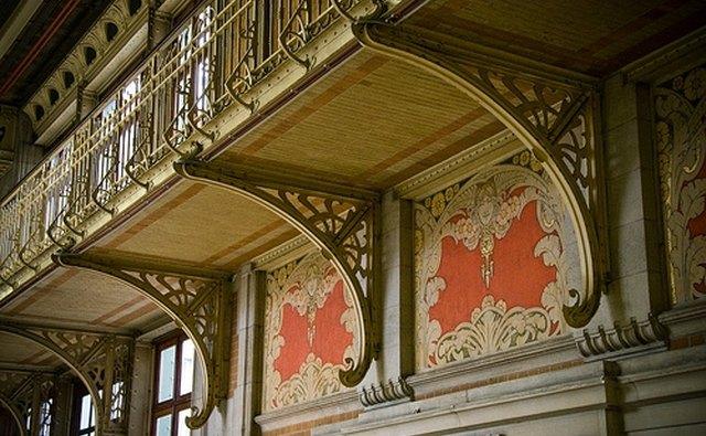Art Nouveau harmonizes floral forms.