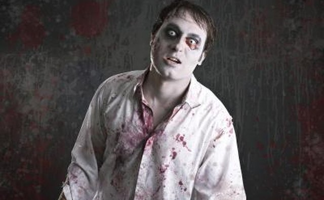 A man is dressed in a zombie costume.