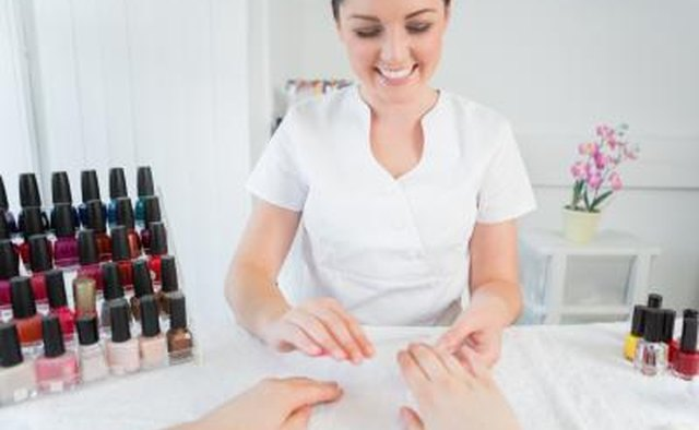 Woman working in nail salon