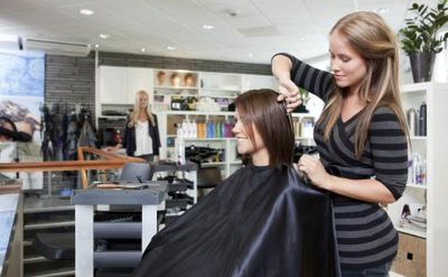 Hair dresser in salon