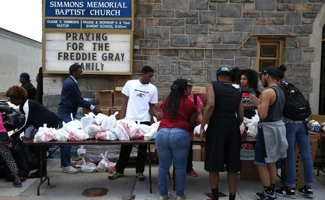 A church distributing bags of food during a food drive.