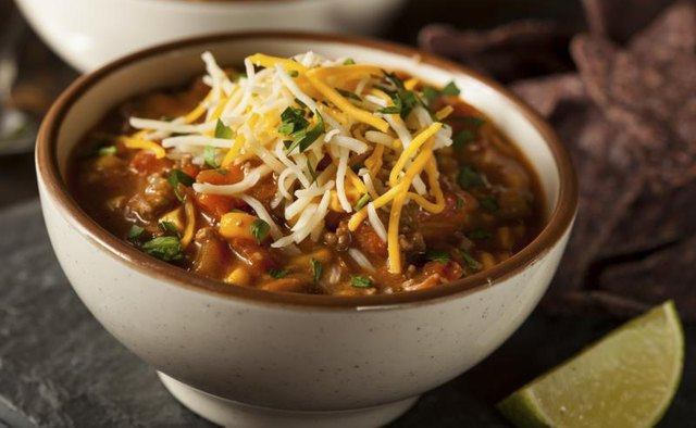 Bowl of chili topped with shredded cheese