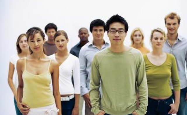 Portrait of young adults standing together.
