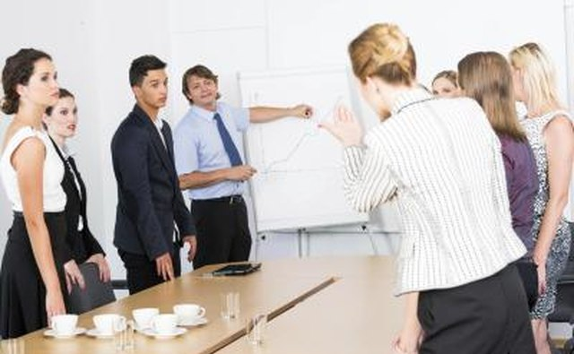 Business woman talks to workers in meeting