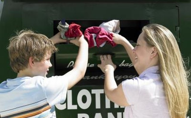 Mother and son donating clothing.