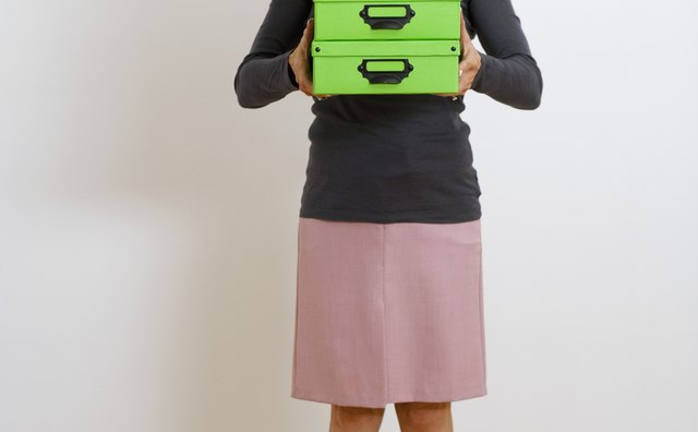 Woman holding stacked boxes