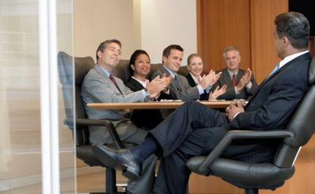 Executives applaud at meeting