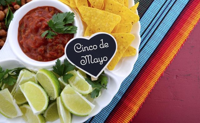 Festive Cinco de Mayo platter with chips, salsa and limes