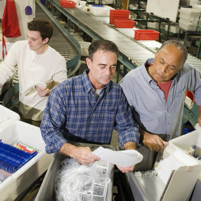 What Factors Influence a Company's Choice of Inventory System?