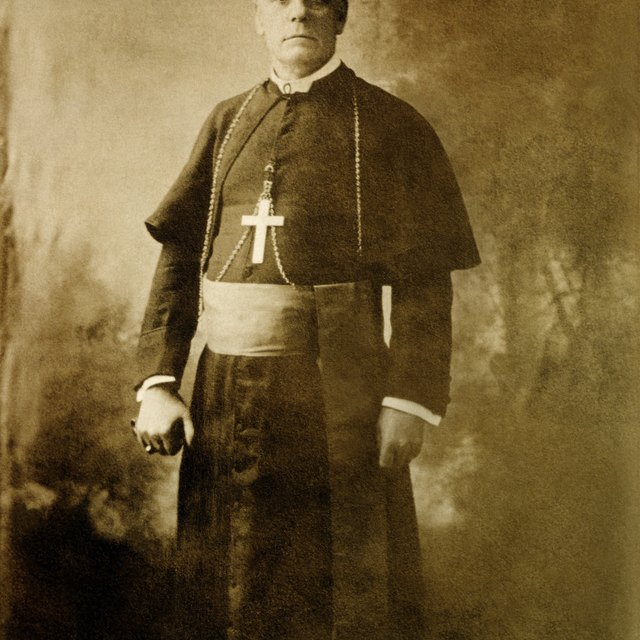 What Is the Difference Between a Catholic Monsignor & a Priest?