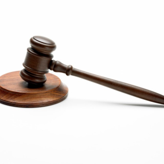 Can a Husband Be Held Responsible for a Wife's Court Fines?