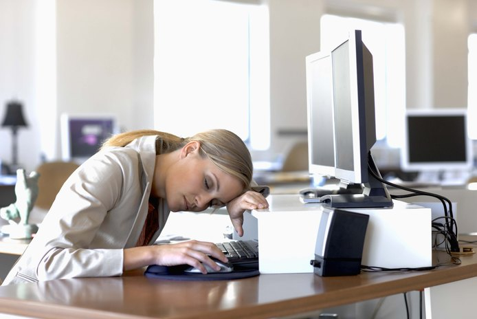 How to Warm Up and Wake Up at a Desk Job