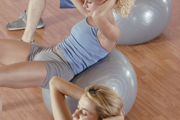 How to Lift Weights to Flatten the Stomach